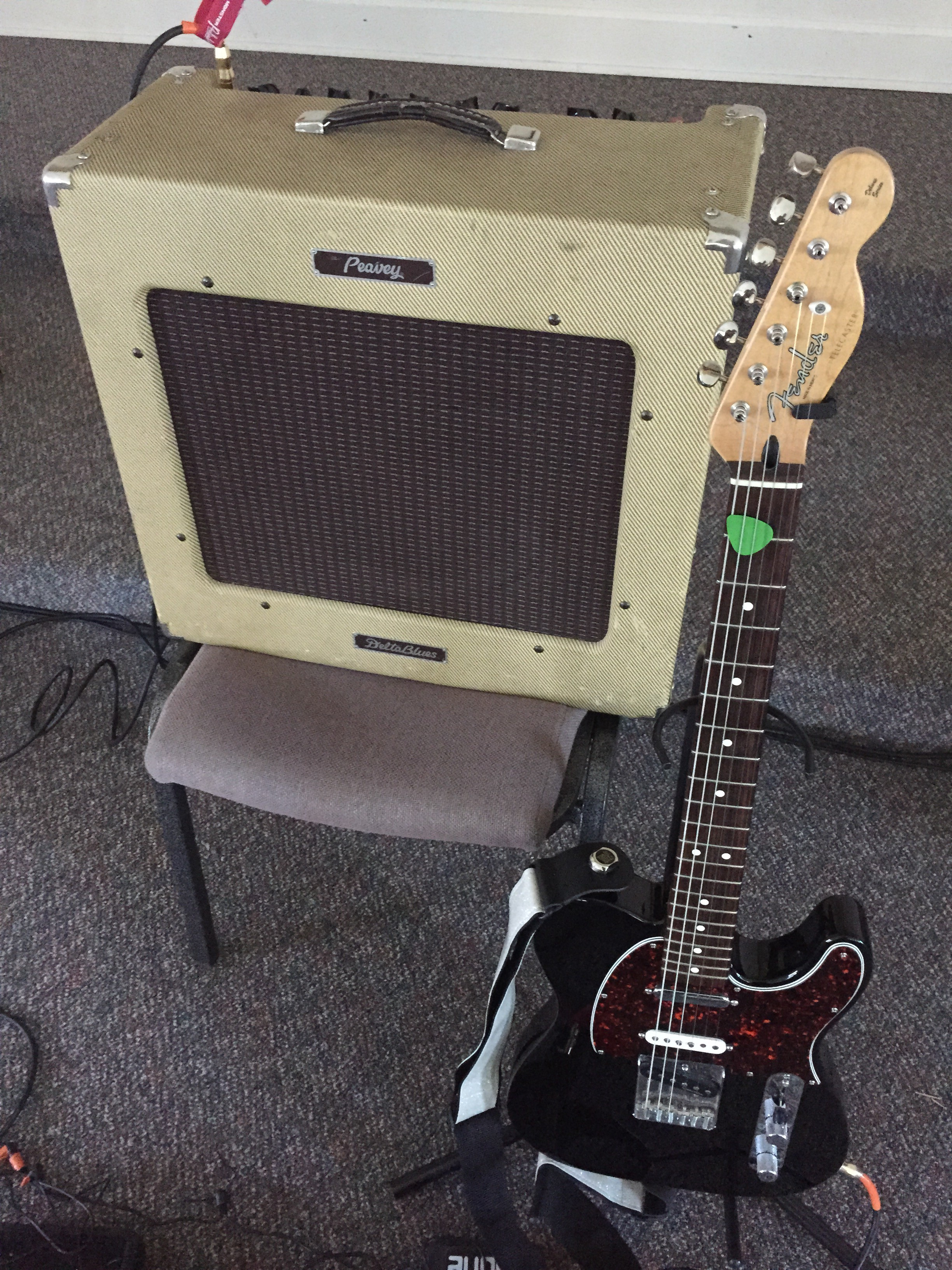 Guitar and amp, set up and ready to go.
