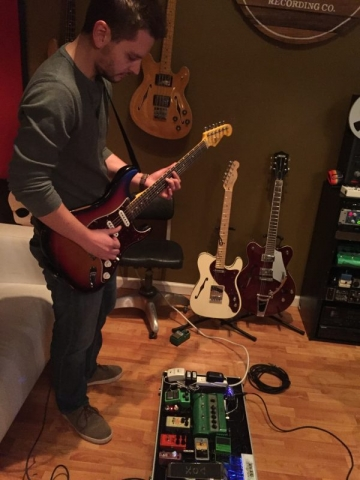 Perry wrapping up lead guitars with his favorite Strat.