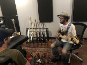 Recording bass in the studio.