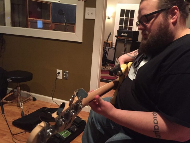 Zack, punching in the last bass track.