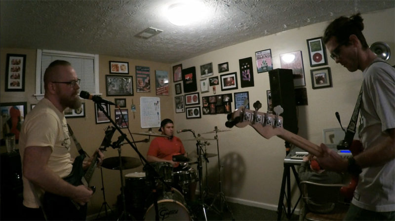 Bandmate meeting in the basement practice lair