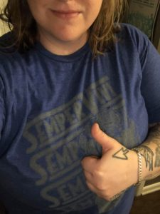 "Our friend Emily gives the ""Flash"" shirt a big thumbs up!"